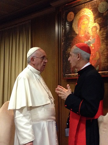 Our Holy Father, Pope Francis, speaks with a Cardinal during the opening session of the Synod in Rome